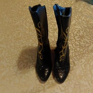 Disney Anna boots size 11/12